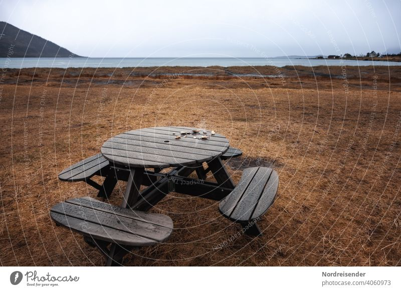 Resting place by the sea in the rain Beach Rain Ocean Camping site bench coast Atlantic Ocean North Atlantic Water Meadow Grass Fjord Senja Island Norway