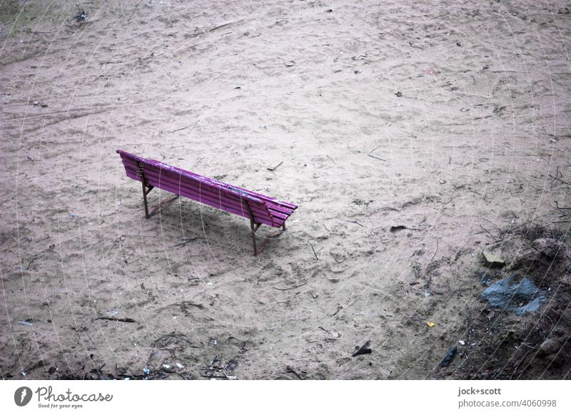 Park bench stands alone on a wasteland Real estate lost places Bird's-eye view Dirty Ravages of time Apocalyptic sentiment Fallow land Downtown Berlin