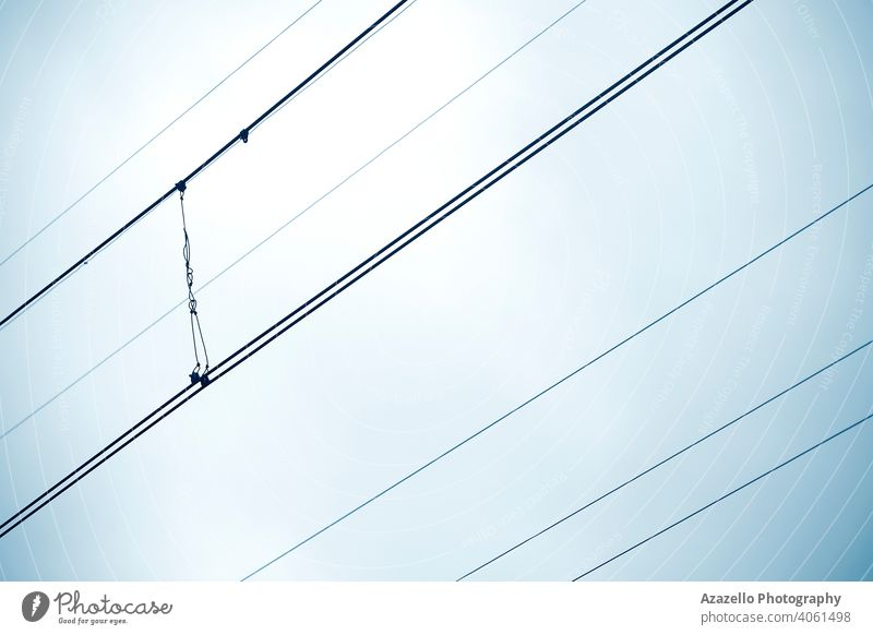 Traction wires view against the sky. Minimalist image of diagonal wires. abstract background black blue business cable current danger design electric electrical