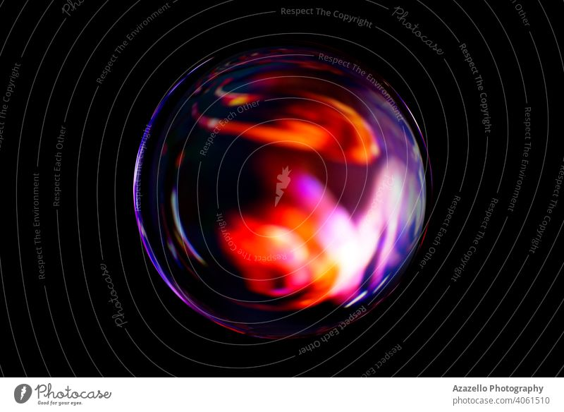 Blurry image of a shiny crystal ball with abstract blurry colorful pattern. Abstract lensball in blur. 3d background beam black black minimalism blue