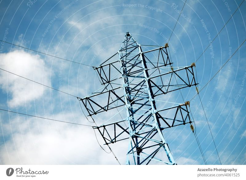 Electricity transmission pylon view against the sky. High voltage line. blue business cable civilization current danger design distribution ecology electric