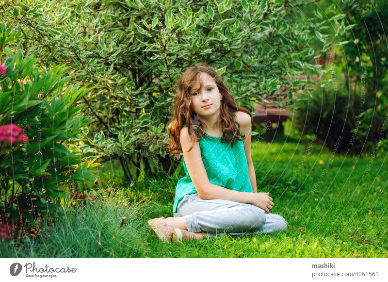 kid girl walking and relaxing in summer beautiful garden child flower nature childhood outdoor happy happiness green cute fun little playing smiling young