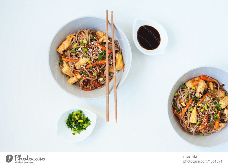 Japanese dish buckwheat soba noodles with chicken and vegetables carrot, onion and baby corn food chopstick bowl meal healthy lunch asian dinner japanese