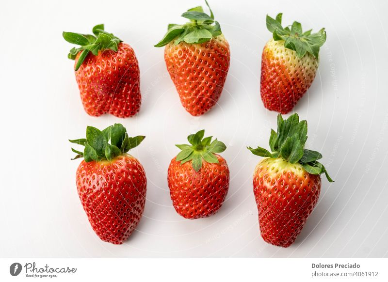 Several large and tasty seasonal strawberries fruit Mature Strawberry Fresh Delicious Red Berries basket group plate green leaf harvest plant ingredient diet
