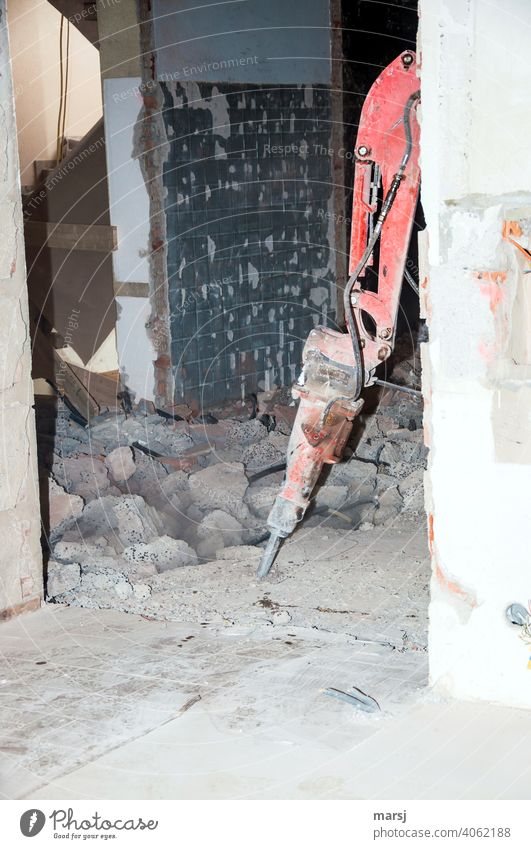 Who's knocking? Interior demolition hammer. Residential renovation Redevelop Housing refurbishment Demolition hammer Hydraulic breaker Modernization Workplace