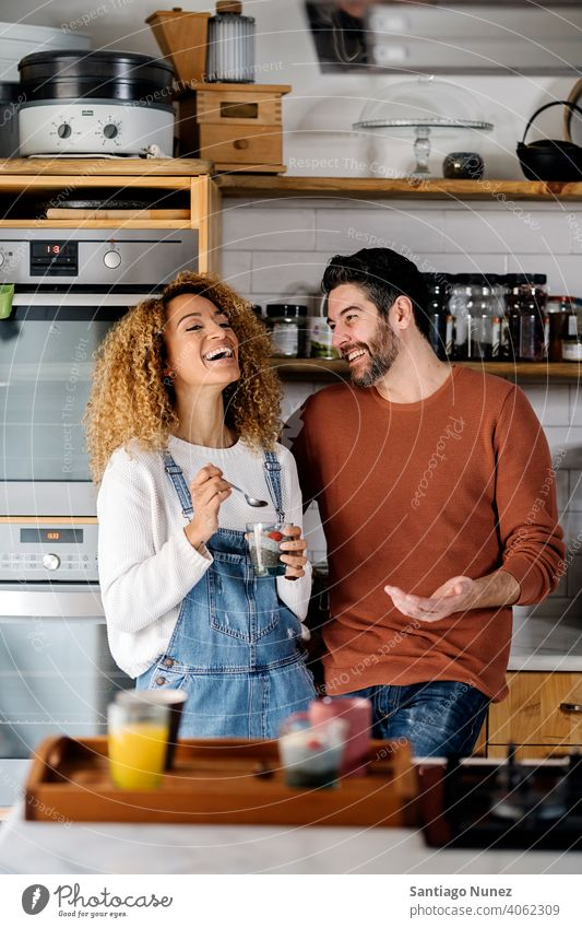 Couple talking in kitchen. middle age couple love cooking home cozy caucasian relationship preparing female happy person stove woman beautiful girl smiling two
