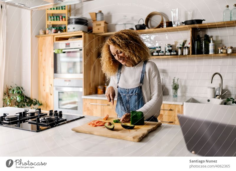 Woman preparing food in kitchen. middle age couple love cooking home cozy caucasian relationship female happy person stove woman alone beautiful girl smiling