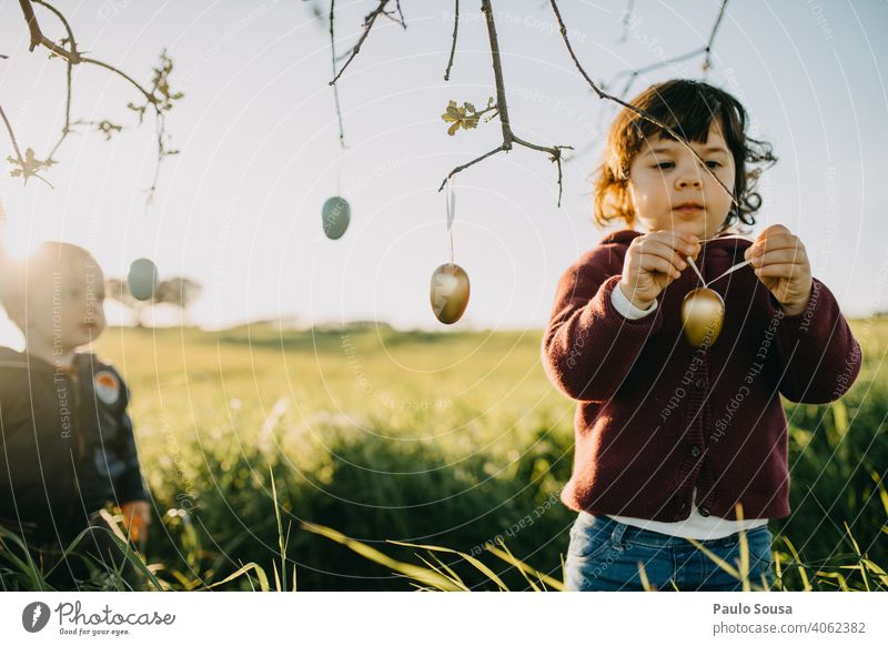 Brother and sister playing with Easter eggs outdoors Brothers and sisters Family & Relations Child 2 1 - 3 years Caucasian Spring Together Happiness Joy Day