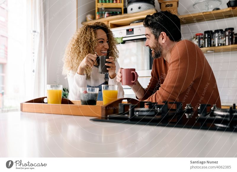 Couple having breakfast in kitchen. middle age couple love cooking home cozy caucasian relationship preparing female happy person stove woman beautiful girl