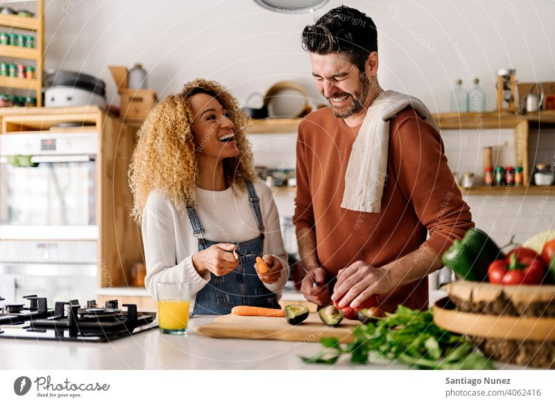 Couple preparing food in kitchen. middle age couple love cooking home cozy caucasian relationship female happy person stove woman beautiful girl smiling two