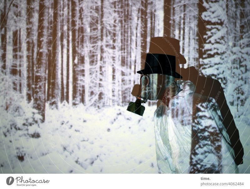 time traveler   corona thoughts Experimental Masculine Stage play Artist Human being Actor Light art Winter Snow Forest Working clothes Respirator mask Cylinder