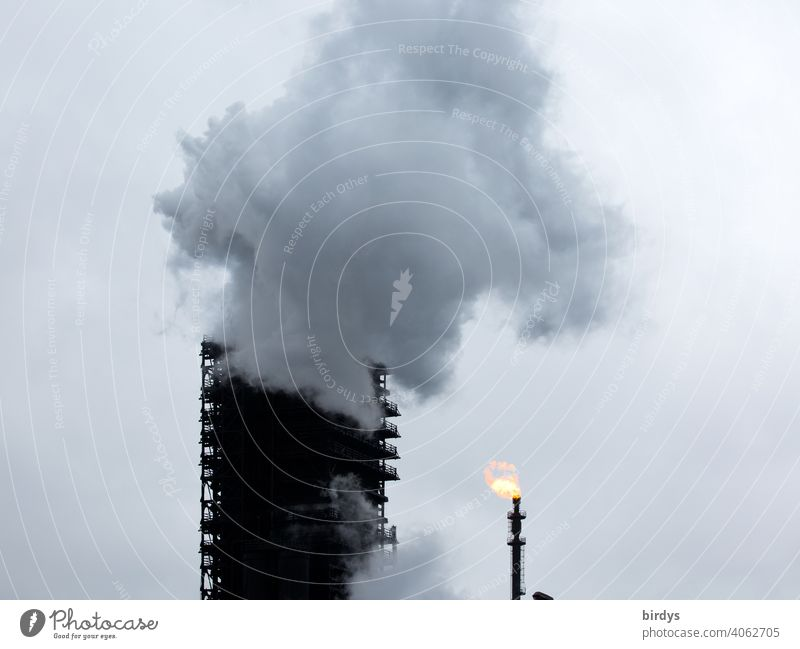 Extinguishing tower of the steelworks Thyssen-Krupp coking plant in Duisburg. enormous steam cloud, extinguishing cloud which arises during the cooling of hot coke in a wooden tower, the extinguishing tower.