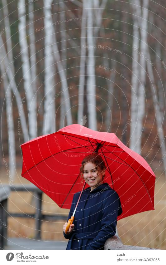 Morning tune Woman Girl Young woman Leisure and hobbies Forest Lanes & trails off Umbrella Umbrellas & Shades Red Sunshade