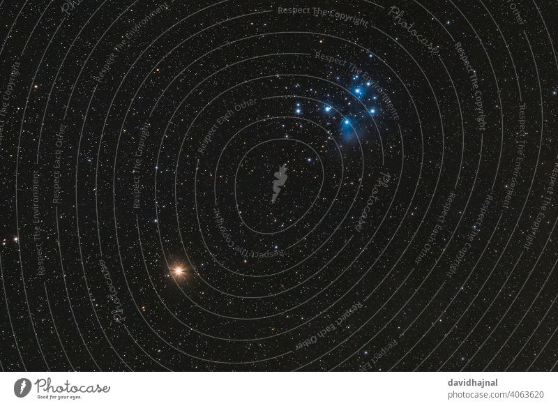 The red planet Mars and the Pleiades in the constellation Taurus on March 6, 2021. Plejades Planet Stars Constellation Golden Gate of the Ecliptic Hyades