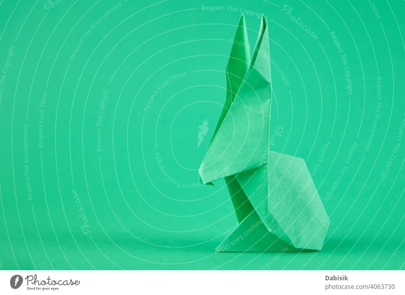 Paper origami Esater rabbit on a green background. Easter celebration concept easter bunny holiday animal decoration spring happy paper cute art colorful