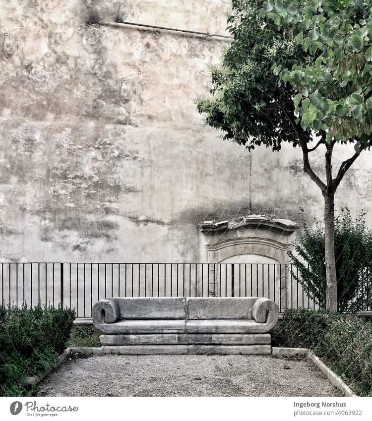 Marble bench in front of ancient wall Bench Deserted Exterior shot Day Colour photo Subdued colour Old Loneliness Copy Space top Empty Seating Calm Stone wall