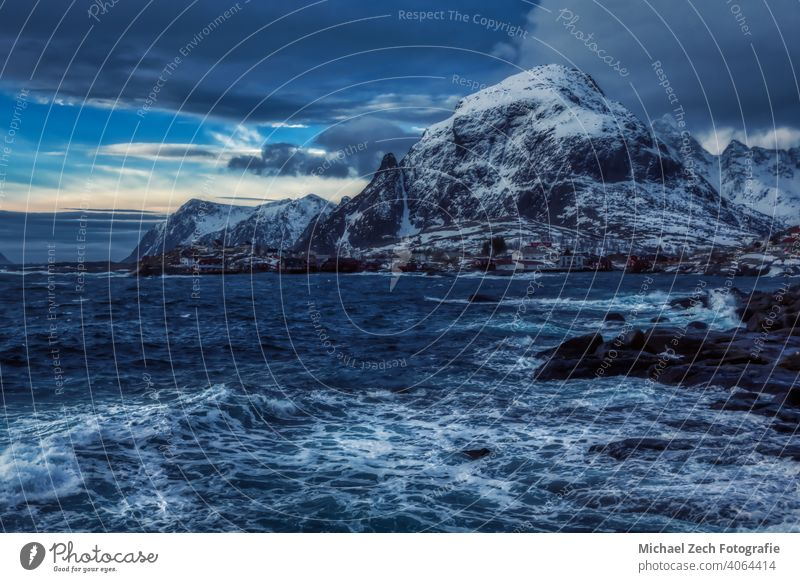 Winter landscape of Lofoten in Norway, where the ocean meets the mountains Countries Places travel Lofotes Snowcapped peak Scandinavia Travel photography
