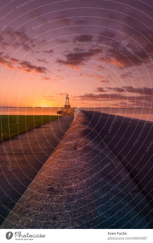 Cross light in Wilhelmshaven during sunset cross light Beacon Sunset Germany Lower Saxony Wilhlemshaven Mole Maritime Navigation Monument
