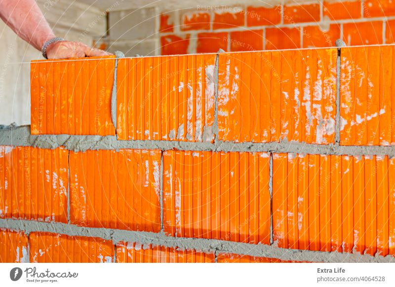 Worker is building wall with red blocks and mortar Accuracy Accurate Activity Architecture Block Brick Bricklayer Bricklaying Brickwork Builder Building Site