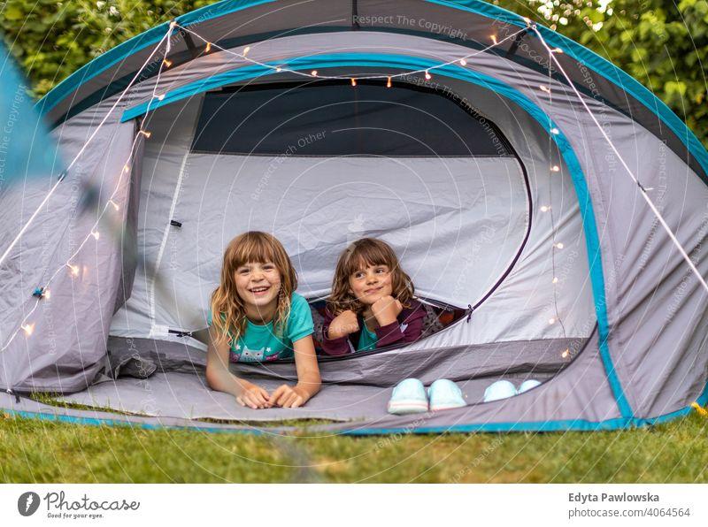 Children enjoying camping holiday hiking cycling vacation tent forest children kids family happy smiling night evening trek trekking Wilderness wild nature