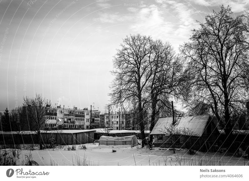landscape with block houses, greenhouse and old shack in winter Aerial background beautiful beauty building country countryside day ecology environment