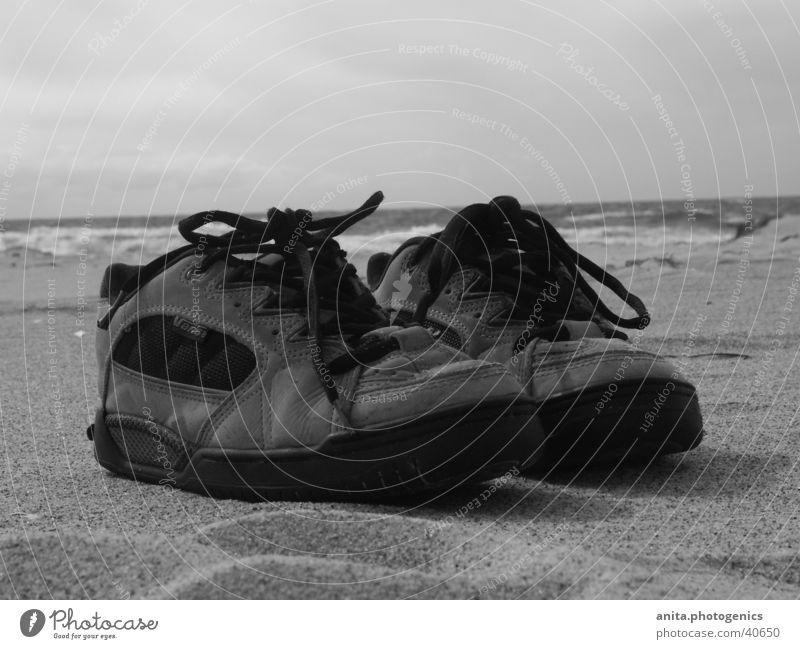 Shoes take a break Footwear Beach Ocean Vacation & Travel Leisure and hobbies Sand Black & white photo