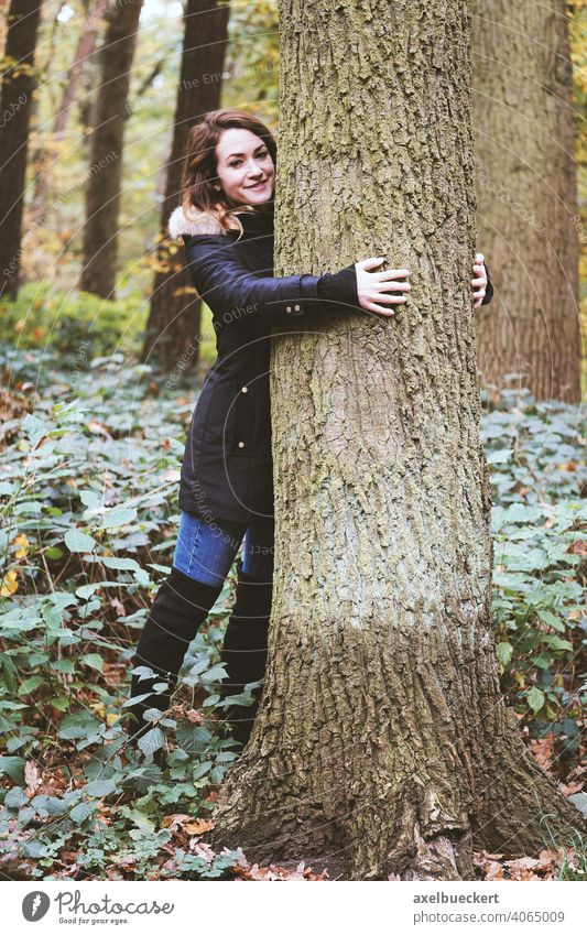 young woman hugging a tree in the forest - nature lover Young woman Tree Embrace Tree trunk Forest Nature Experiencing nature Love of nature nature lovers