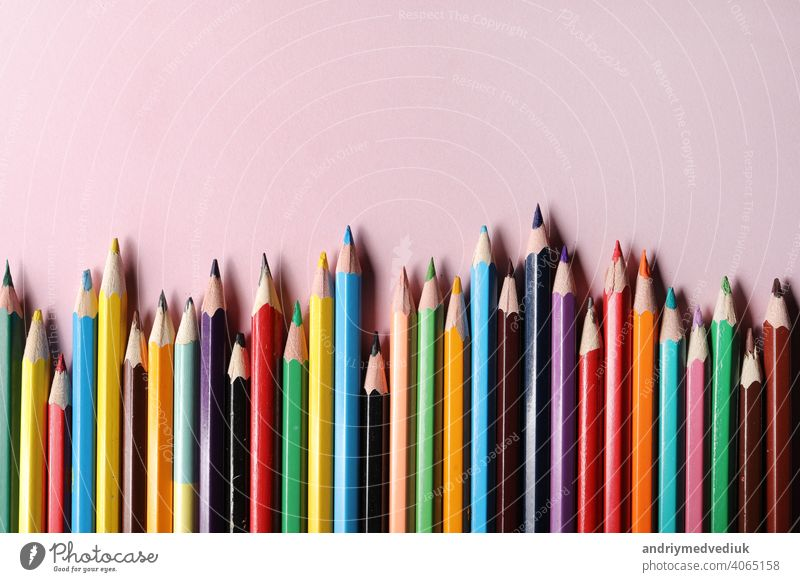 Color pencils set, row wooden color pencils isolated on pink background. colored pencils for drawing. copy space. up close sharp rainbow group green education