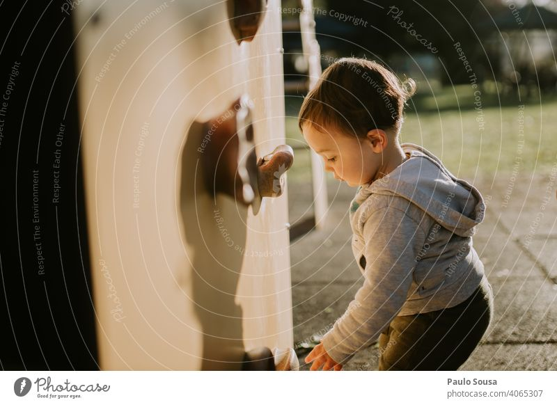 Child playing at playground Caucasian 1 - 3 years Authentic Playing Climbing wall Playground Park Happiness Happy Toddler Day Infancy Human being Colour photo
