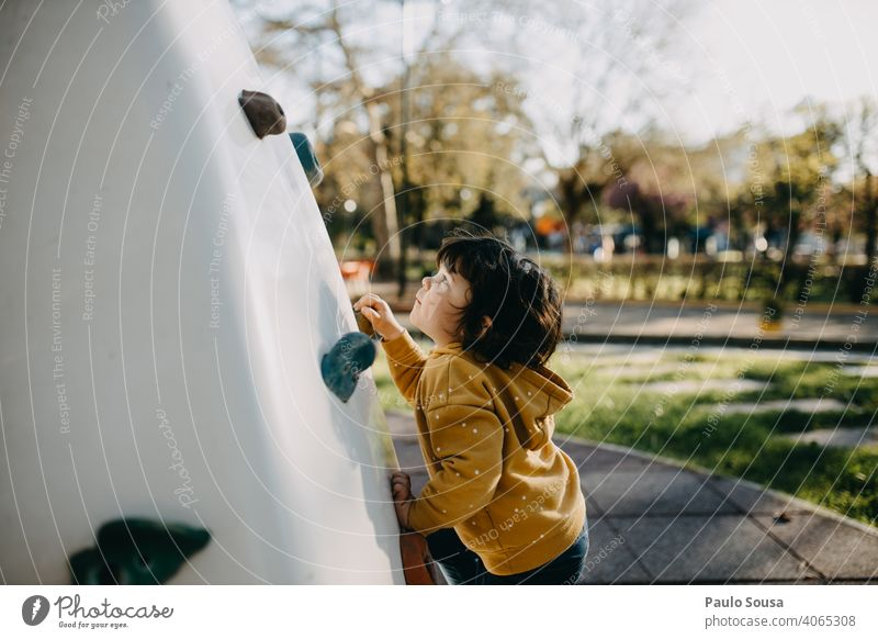 Child climbing wall at playground childhood Girl Caucasian 1 - 3 years Climbing Playing Playground Lifestyle Happiness Day Leisure and hobbies Exterior shot