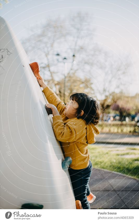 Child playing at climbing wall Climbing Climbing wall Playing Playground Park childhood Children's game Adventure Happiness Kindergarten Human being Toddler