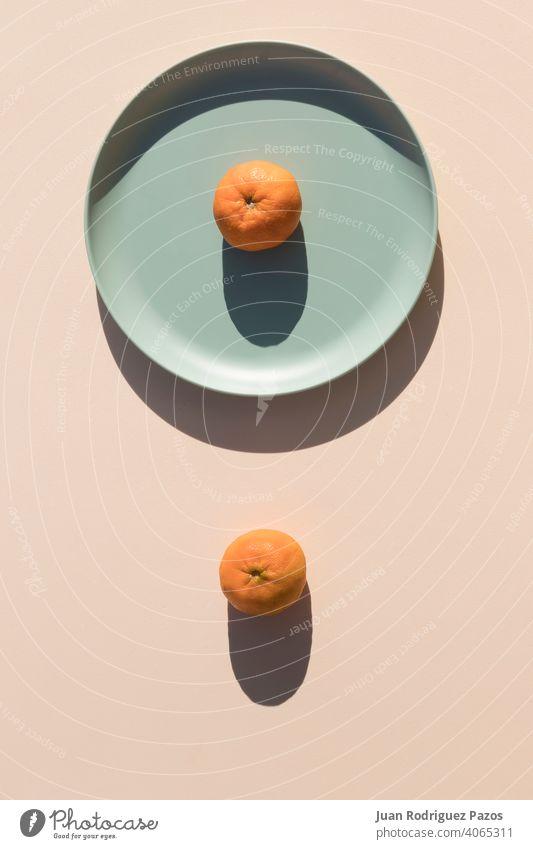 Minimalist image of two mandarins minimal geometric shape hard shadows healthy fruit rounded orange color minimalist shade vitamin simplicity tangerine citrus