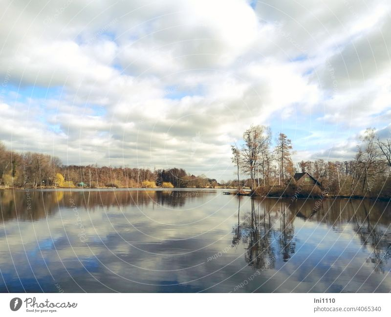 Cloudy sky reflected in small moor lake Bog Lake idyllically Idyll Panorama (View) silent sunshine Winter mood reflection Clouds in the sky