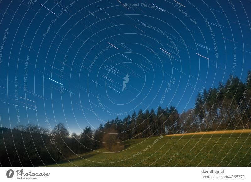 Star trails over the Odenwald near Lampenhain. Dusk Moonlight grove of lamps Germany Europe Mountain Night Starry Path star trails Stars Follow-up Hiking trails