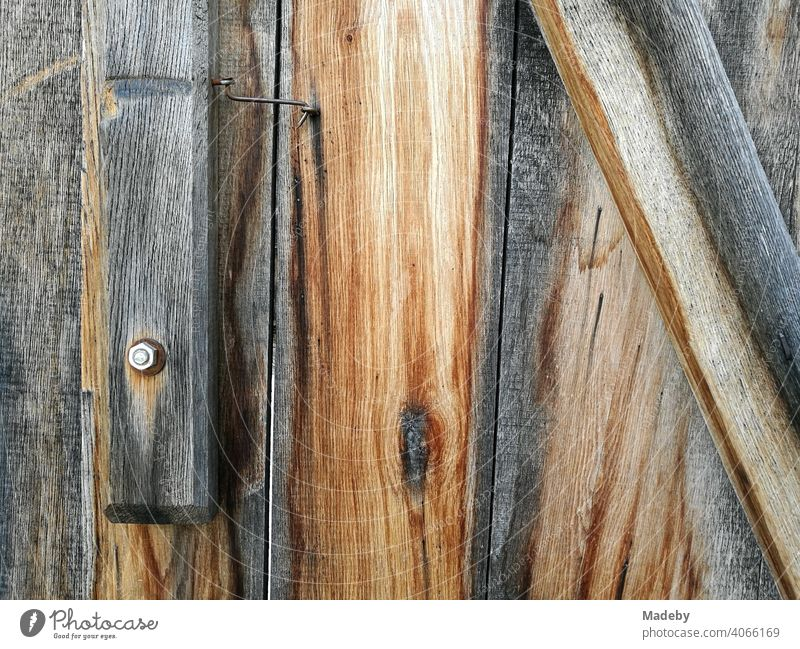 Untreated weathered wood with screw and nut of a wooden house in the Farmhouse Museum in Bielefeld Olderdissen in the Teutoburg Forest in East Westphalia-Lippe