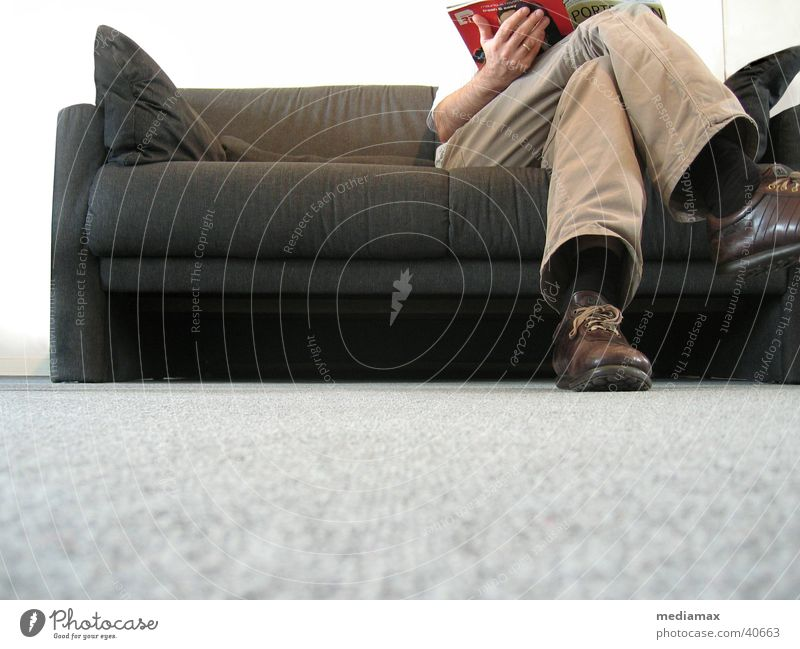 waiting Reading Relaxation Sofa Worm's-eye view Cushion Human being Wait Legs legs crossed Sit