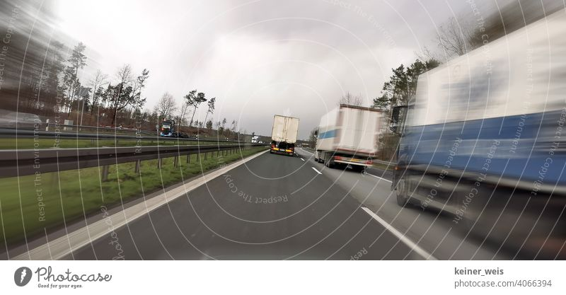 Trucks block the passing lane on the two-lane highway Transport Road traffic Colour photo Motoring Traffic infrastructure Exterior shot Means of transport