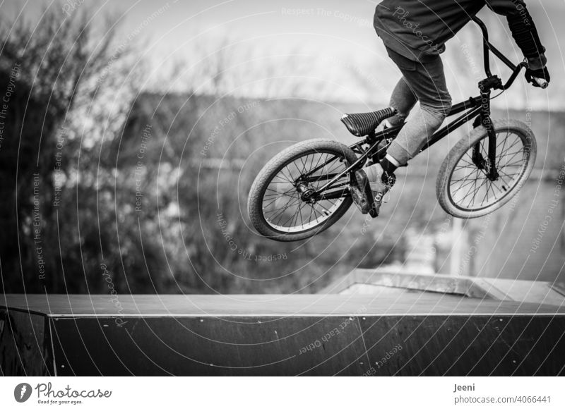 Teen jumps over ramp on BMX bike Bicycle Stunt Ramp Jump Tall across Youth (Young adults) teen younger youthful Child Infancy adolescence Youthfulness Sports