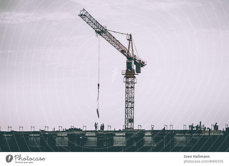 crane over working people Baustelle arbeiter kran last Crane Construction site Construction crane Build Building Industry construction Town Sky Deserted