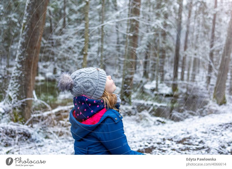Little girl enjoying a walk through the woodland in winter trees child snow forest cold wilderness hiking active beautiful bialowieza childhood december dense