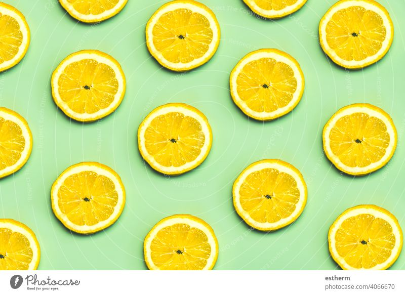Top view of creative pattern made of lemons slices lemon slice natural fruit citrus food healthy fresh summer background yellow sweet texture abstract juice