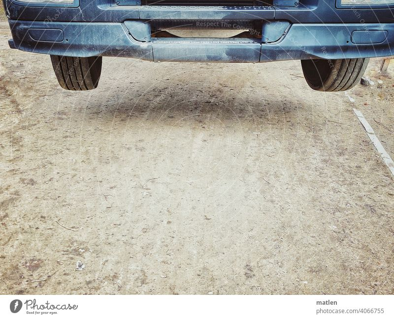 Withdrawn Aloof Traction Bumper Hover Tire Wheel Ground Exterior shot Colour photo Deserted lorry Driveway Detail