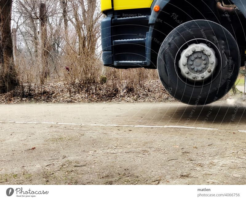 lost contact with the ground Traction Without off Wheel lorry trees Exterior shot contactless Deserted Indicator light driver's cab Tire Colour photo Hover