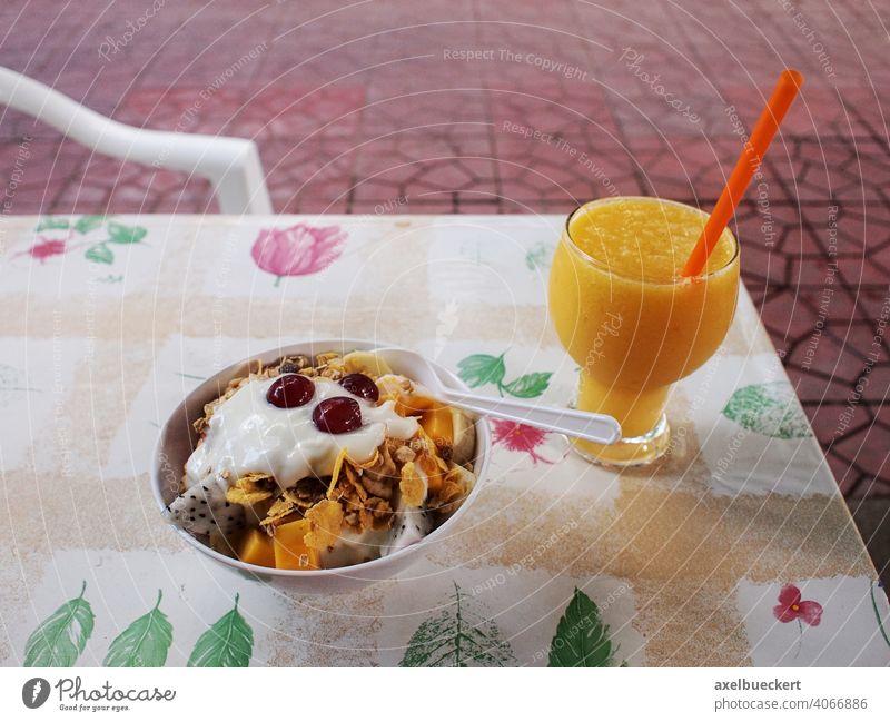 healthy breakfast with muesli fresh fruits and freshly squeezed orange juice Breakfast Healthy Eating Cereal Juice freshly-squeezed Orange juice Nutrition