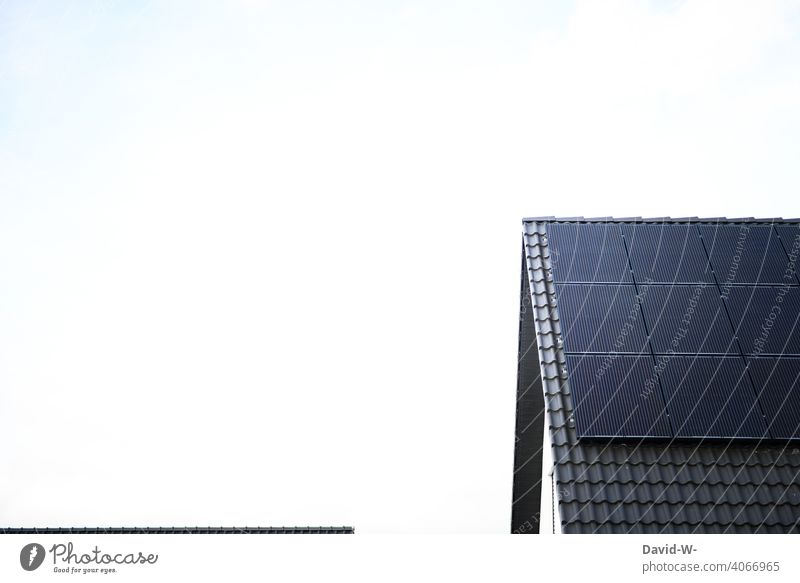 Modern photovoltaic system on the roof of a residential building photovoltaics Solar Energy Innovative solar panel Climate sunshine Environment Solar cells