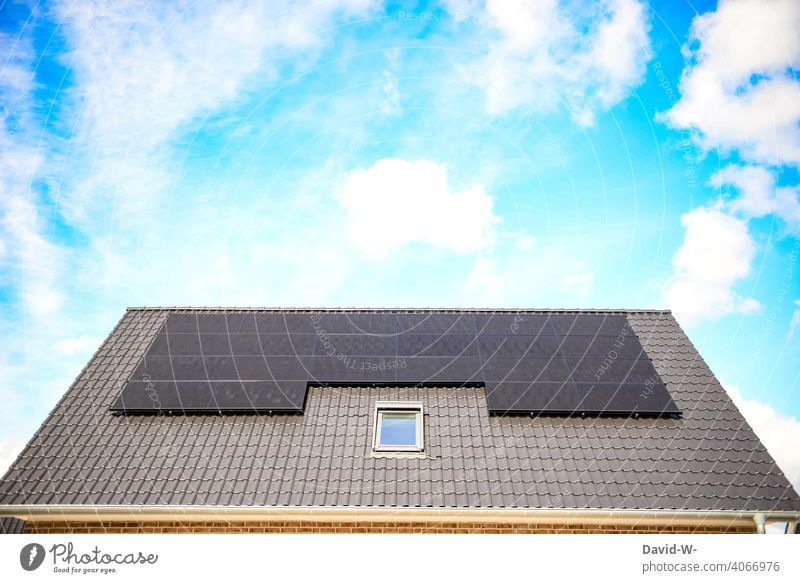 Solar system on a roof in good weather and sunshine Modern Beautiful weather Roof Renewable energy photovoltaics Sustainability Solar Power Solar Energy