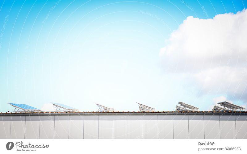 Solar cells / photovoltaics on the roof illuminated by sunlight photovoltaic system Sunlight Roof light energy Renewable energy Eco-friendly
