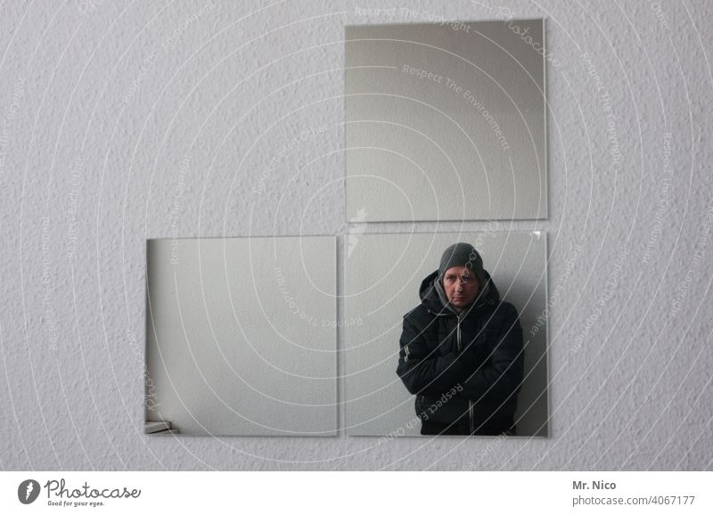 mirror image Mirror Mirror image Man Reflection Self portrait Upper body Looking Wall (building) Gray Cold Jacket Cap Interior shot crossed arms Exceptional