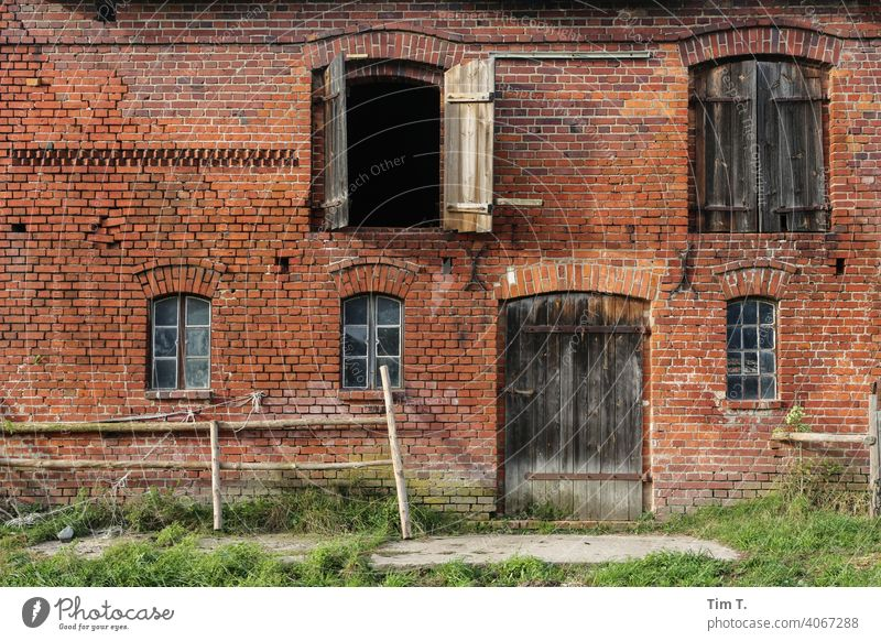the facade of a stable building Barn stables Farm Agriculture Colour photo Deserted Exterior shot Day Farmer Courtyard agriculture Building Village door Rural