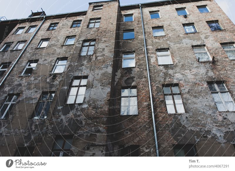 View upwards in an old Berlin backyard Prenzlauer Berg Old building Backyard Winter Courtyard Deserted Town Day House (Residential Structure) Downtown Old town